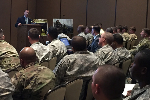 USDA Deputy Under Secretary Lanon Baccam talks futures in Ag for veterans to a packed house at a Ft. Bliss transitions summit in El Paso, Texas.